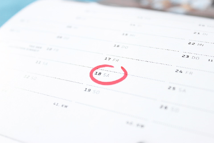 White calendar with Saturday circled in red