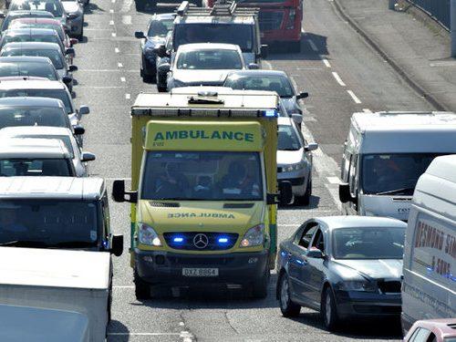 Ambulance moving through traffic