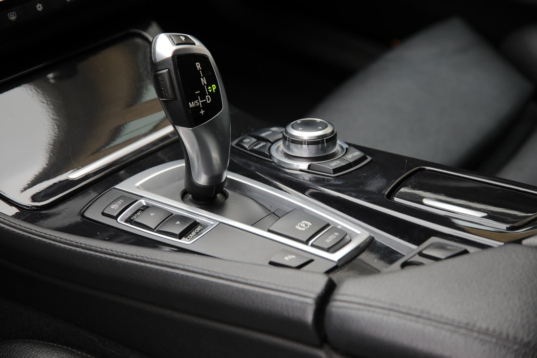 Close up of an automatic gearshift within a car