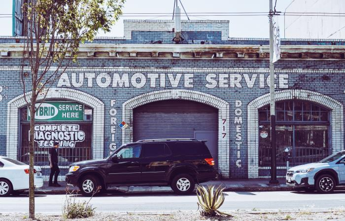 Automotive service building with cars outside