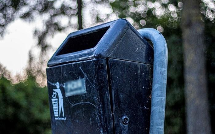 Black bin in public park