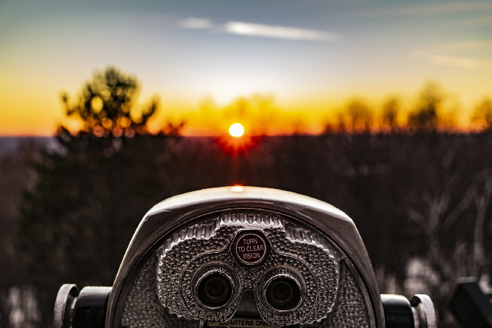 Binoculars looking out towards sun setting