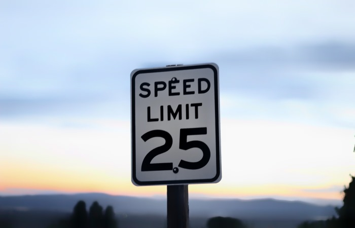 Black and white 25mph speed limit sign