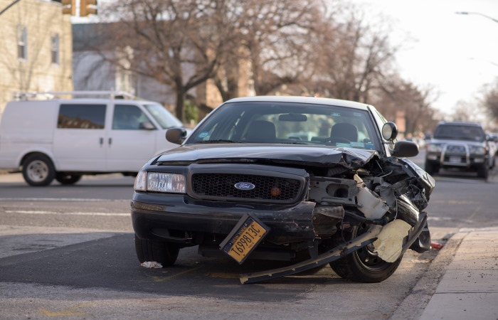 Black car with damage from car accident