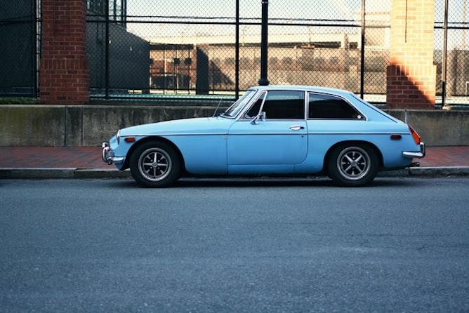 A blue car parked on a street