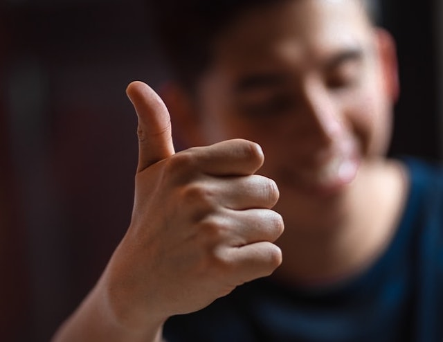 A boy doing thumbs up