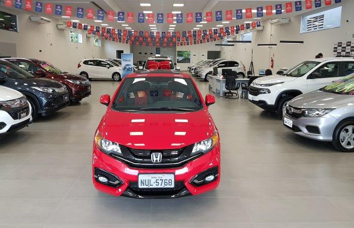 New red Honda in car dealership