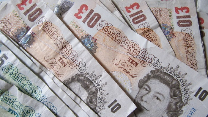 Close up of £10 and £5 notes