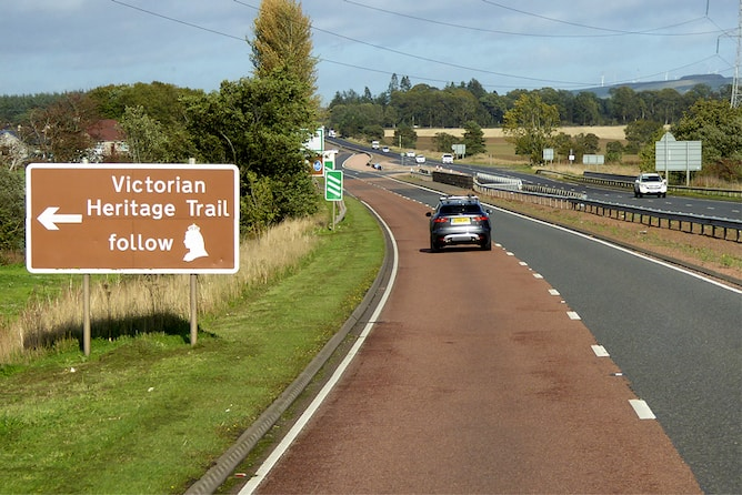 A brown tourist sign points to a Victorian heritage trail