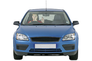 A driver in a blue car holding her hand up