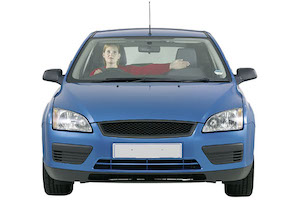 A driver in a blue car holding her arm out to her left