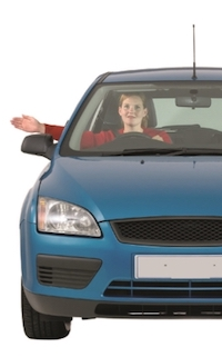 A driver in a blue car holding her arm out of the window to her right