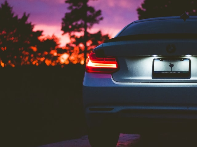 Car displaying brake lights at sunset