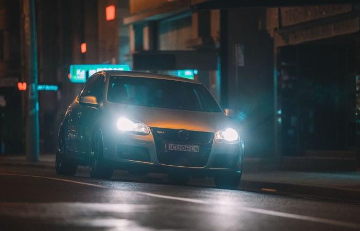 Car headlights on grey car at night