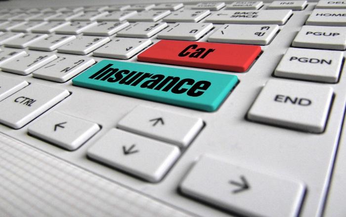 Keys labelled car insurance on a keyboard