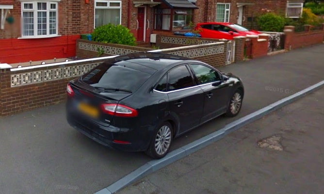 Car parked on pavement