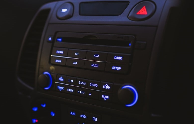 Close-up of a black car stereo lit up