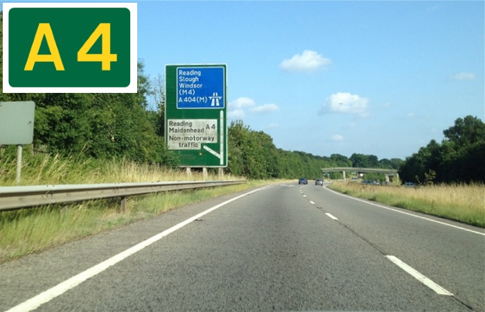 Cars driving on the A4 with road sign in corner