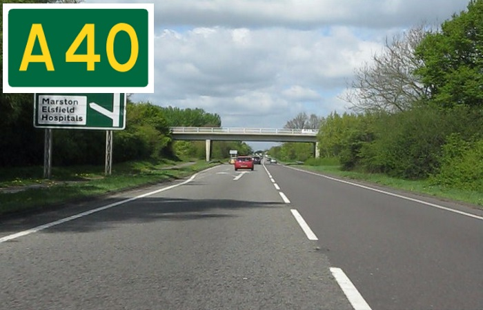 Cars driving on the A40 with road sign in the corner