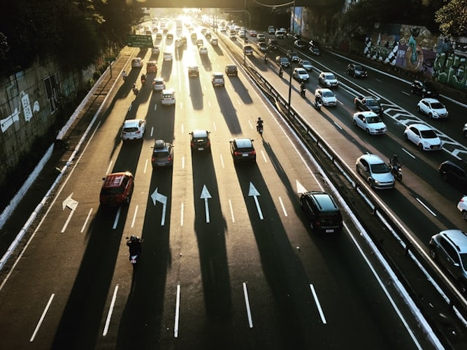 Cars in many lanes along a busy motorway