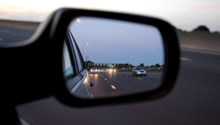 Cars reflected in car side mirror