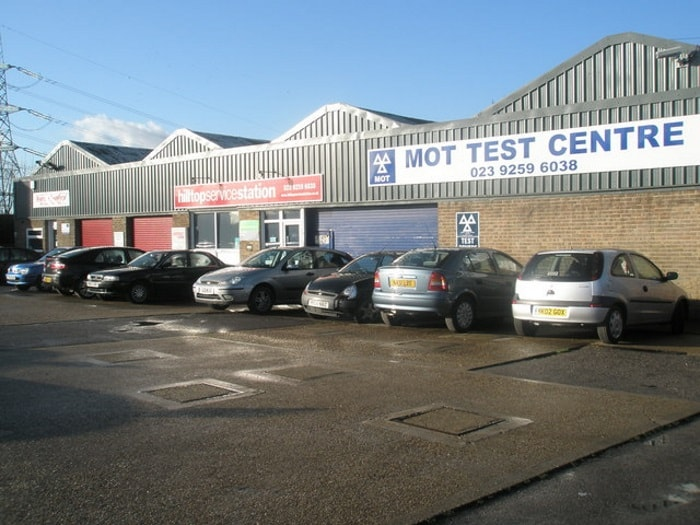 Image of cars waiting outside an MOT centre