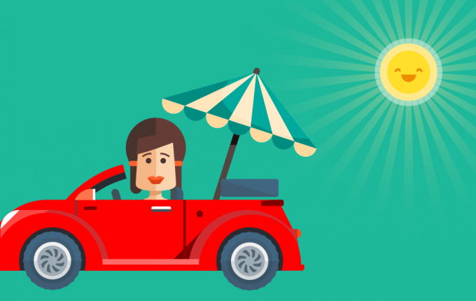 Woman in car with parasol blocking the sun