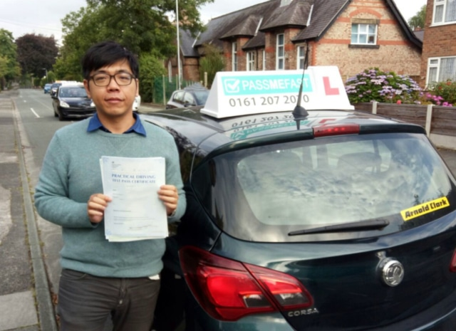 Chen-Wei with his pass certificate and learner car