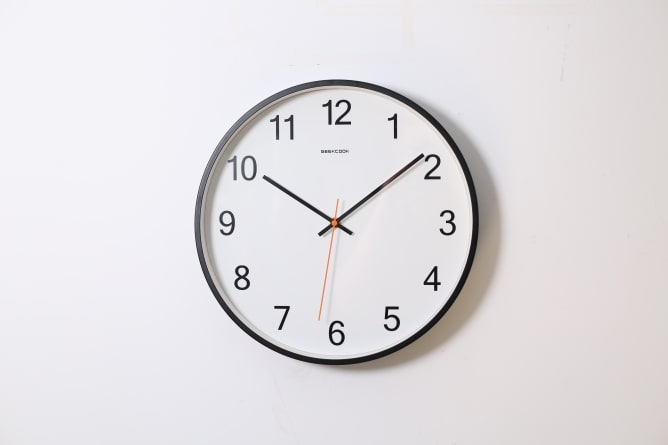 Clock on wall showing time of 10 past 10