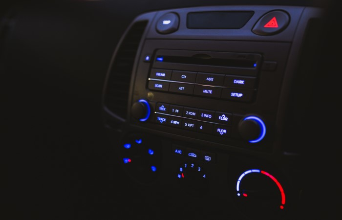 close up of car stereo and hazard warning button