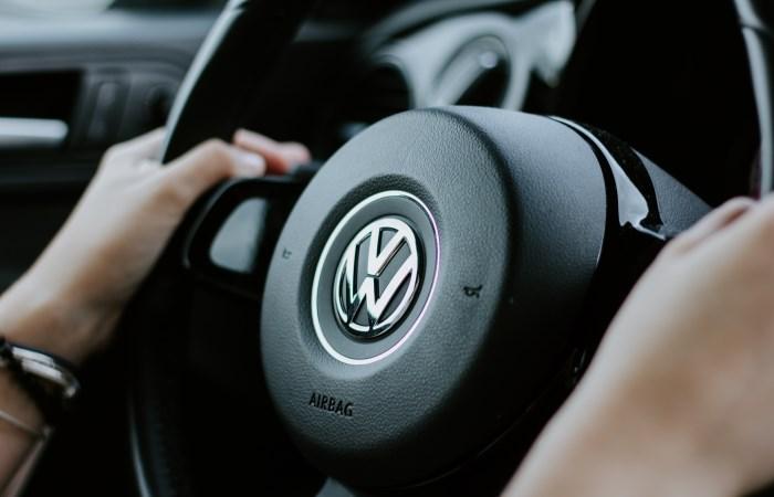 Close up of hands on Volkswagen steering wheel