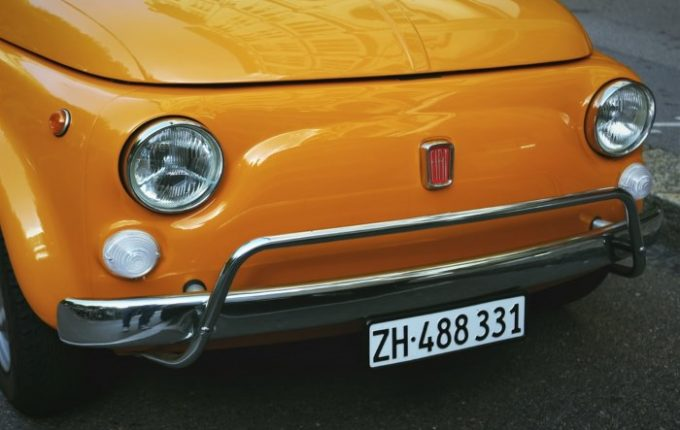 Close-up of an orange car's headlights