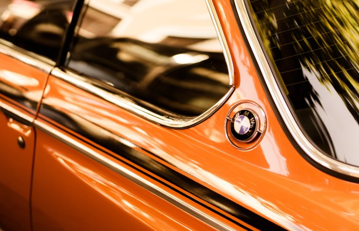 Close up of window on orange BMW