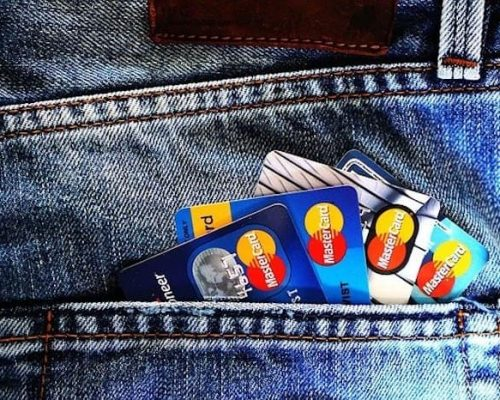 Credit cars fanning out of a jeans pocket