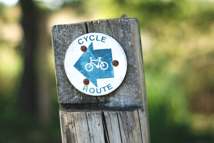 Cycle route sign attached to wooden post