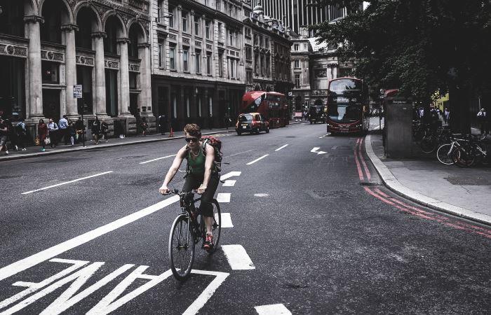 cyclist-riding-around-london