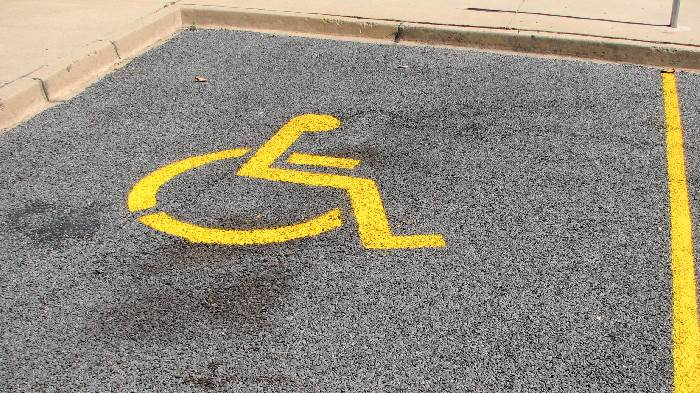 Yellow markings on ground to denote a disable parking space