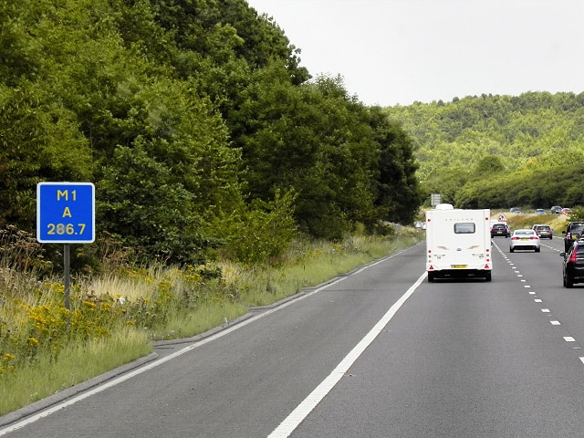 A driver location sign beside the M1