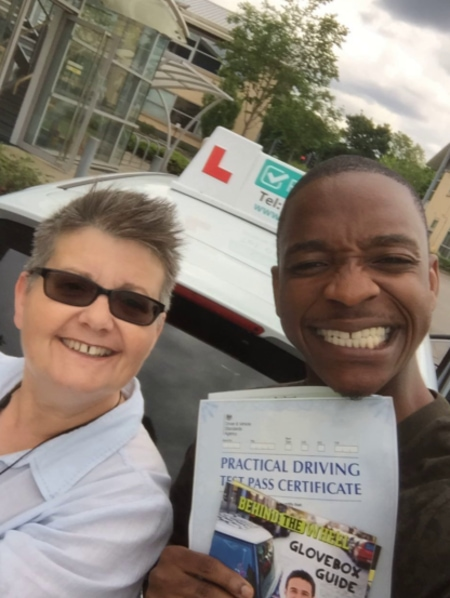 Eugene with his pass certificate and driving instructor