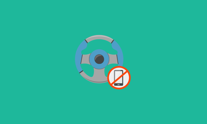 Steering wheel with mobile phone warning sign