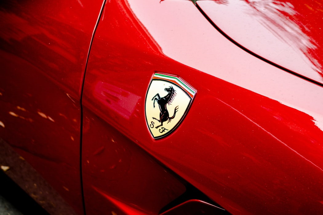 Ferrari badge on red car