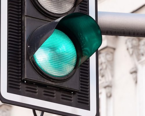 Close up of illuminated green traffic light