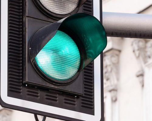 Close up of illuminated green traffic light