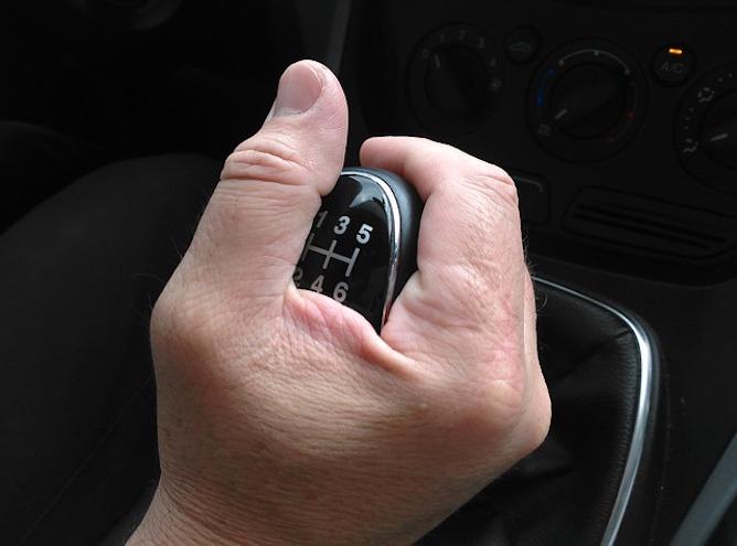 A hand holding a gear stick