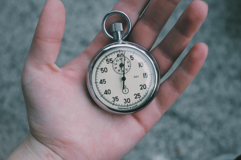 Hand holding a vintage Soviet stopwatch
