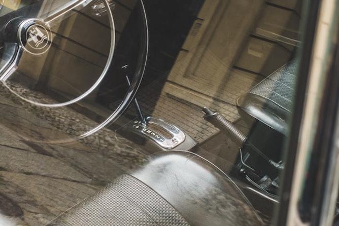 A handbrake as seen through a car's window
