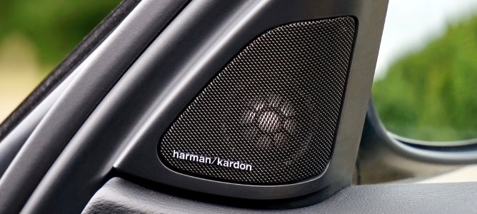 Harman Kardon speaker mounted in a car's A-pillar