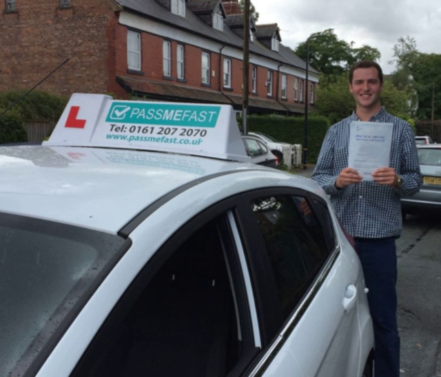 Harrison with his pass certificate and learner car