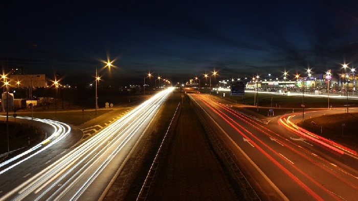Motorway at night with lights from cars