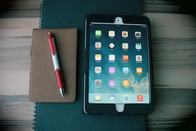 iPad with notebook and pen